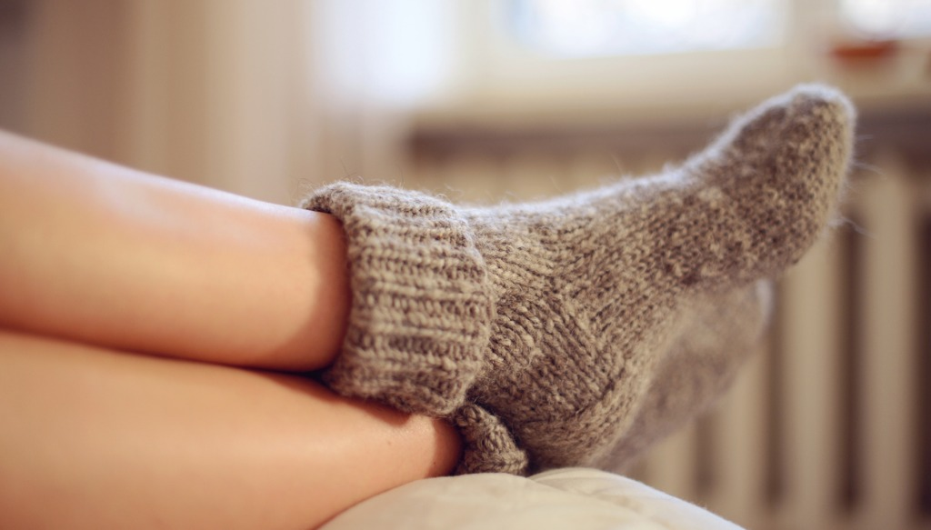 woman wearing socks with radiator in background