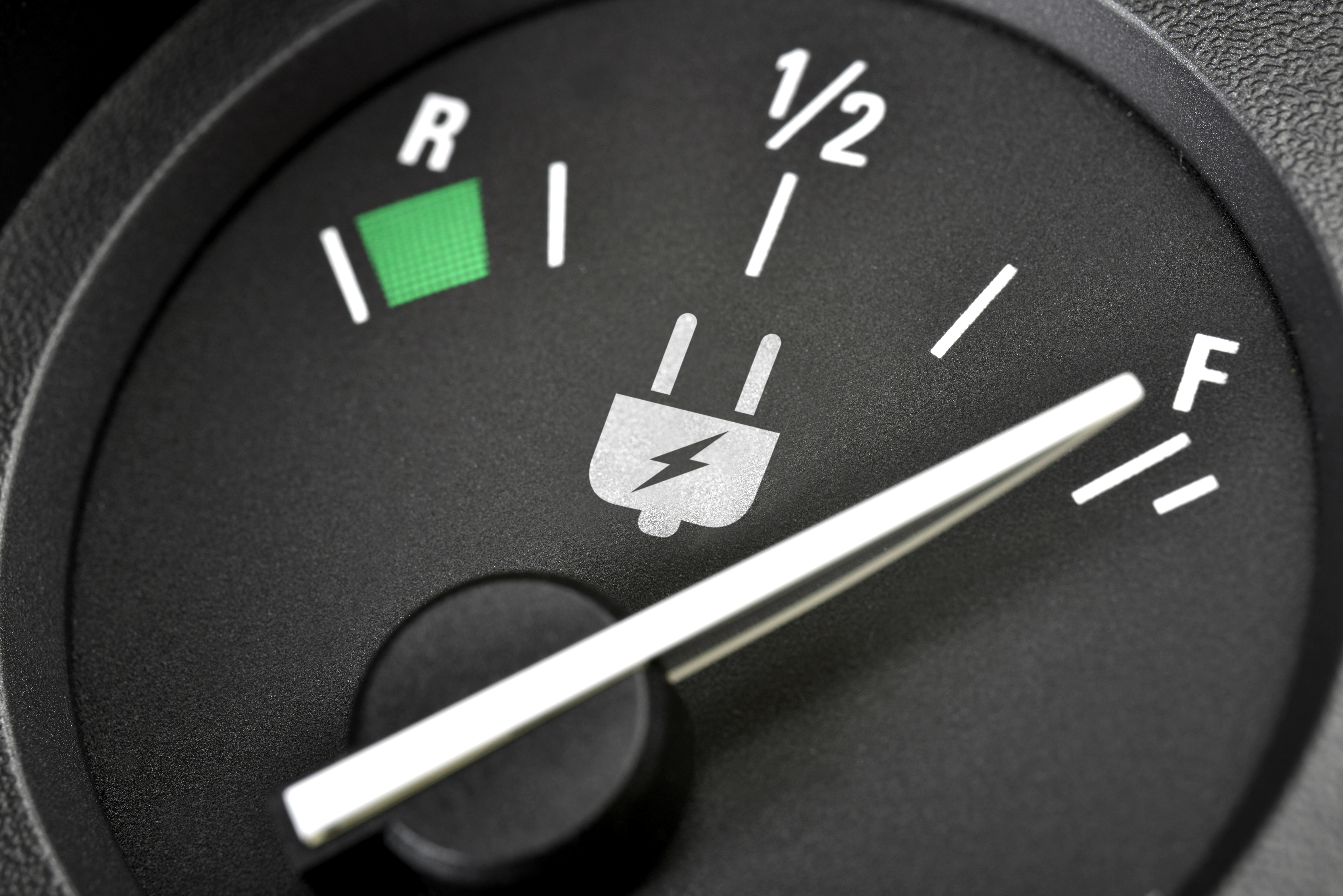 recharge dial in an electric car showing battery as full and when to recharge the car