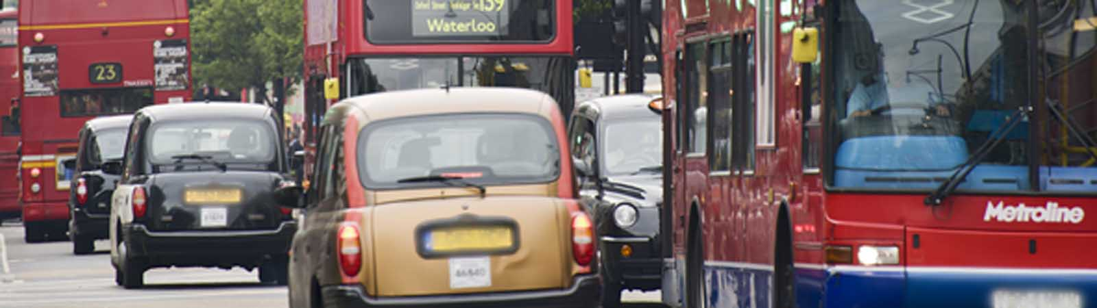 London taxis and buses in traffic