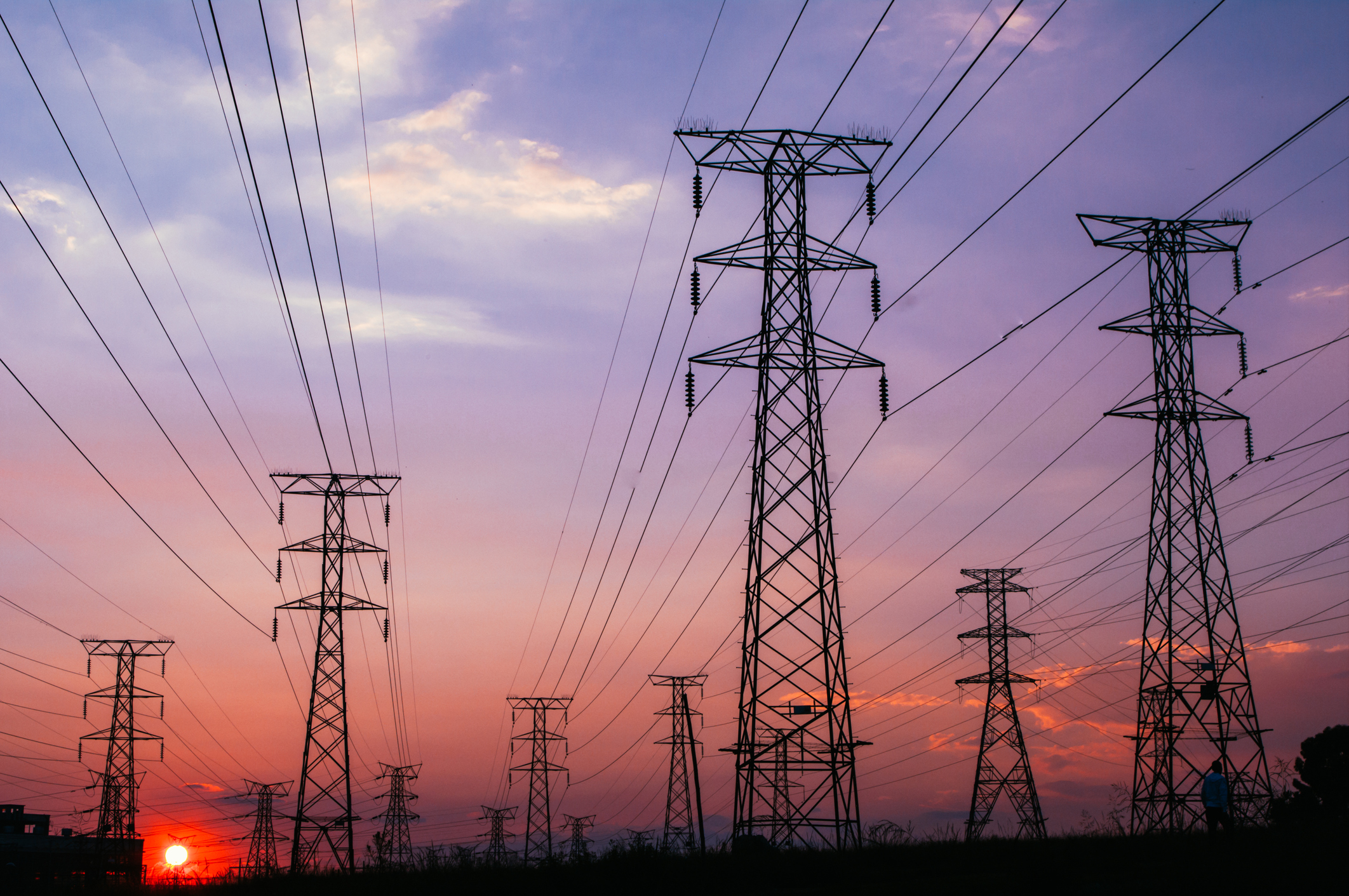 pylons and power cables stretching away into the sunset