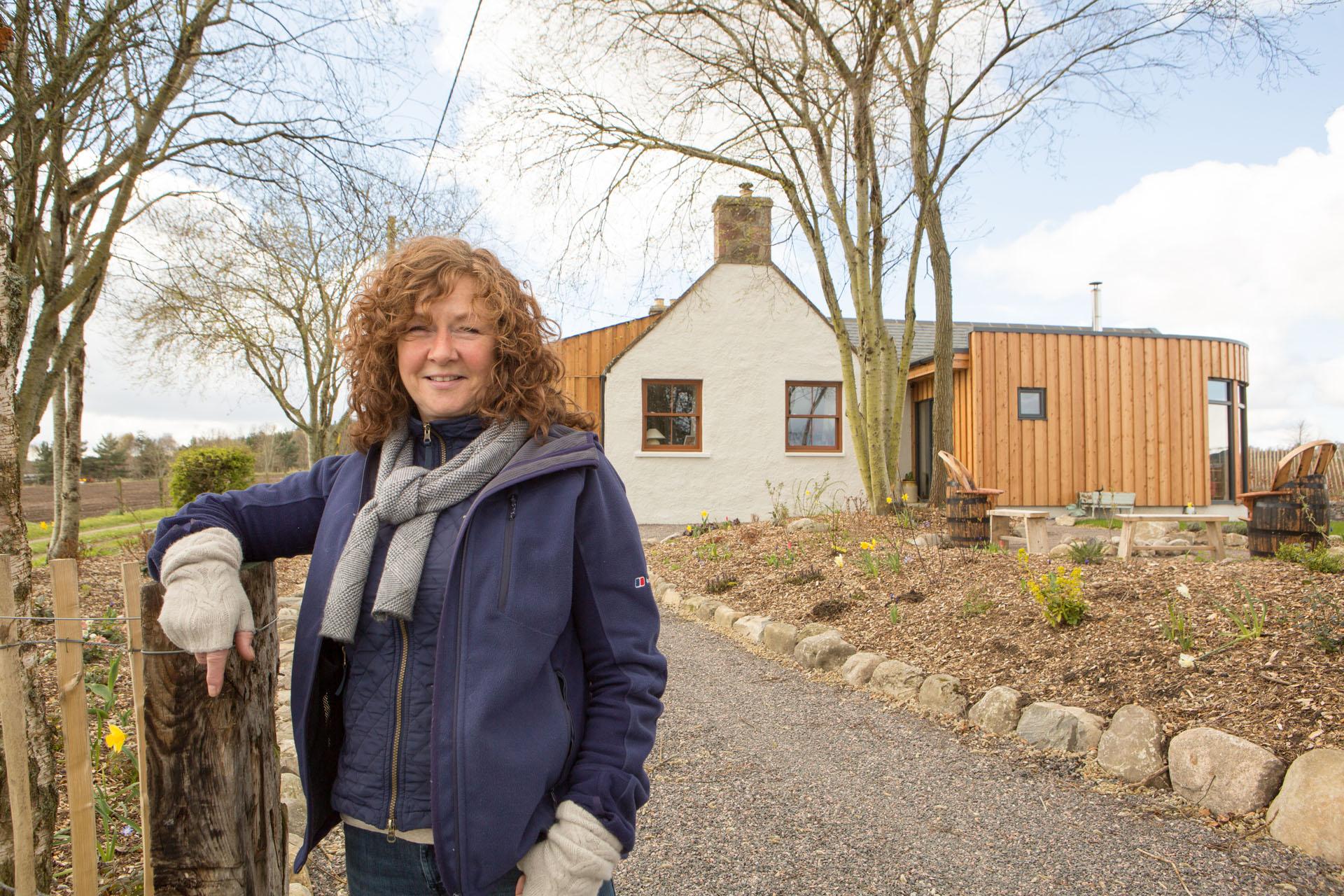 Caroline renewables user outside her home