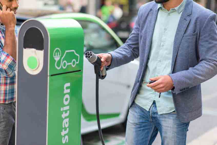 Plugging in an electric vehicle at a charging station