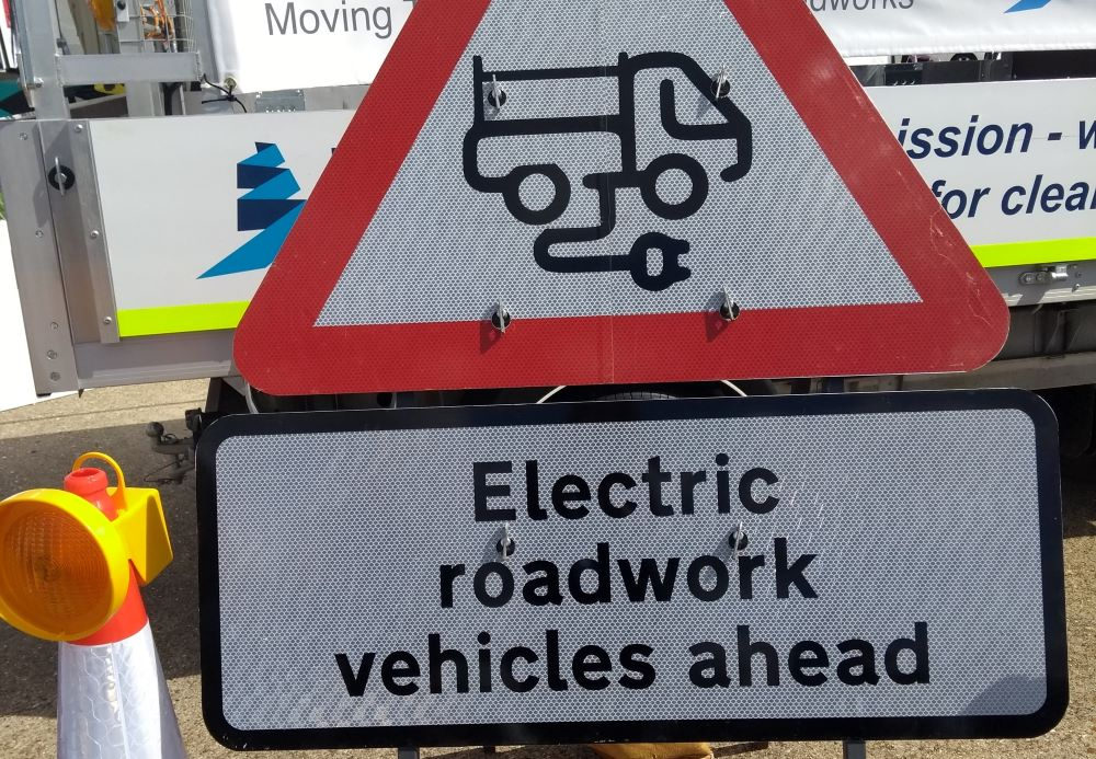 Roadsign with 'electric roadwork vehicles ahead'