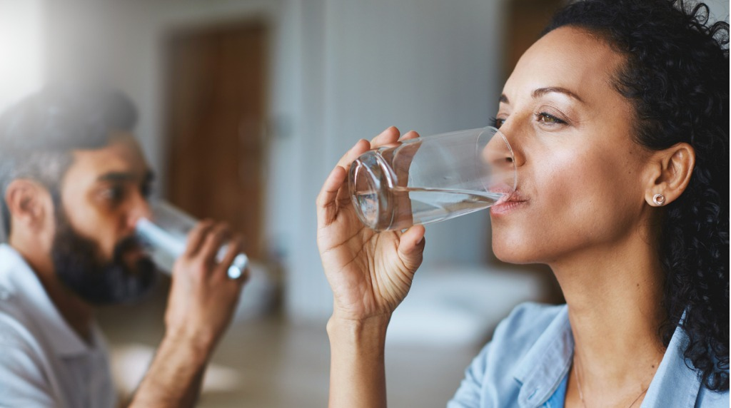 Man and woman drinking water from glasses