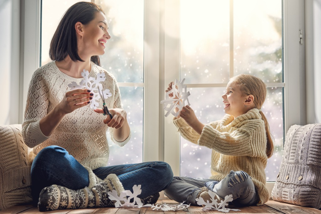 woman and child making snowflakes