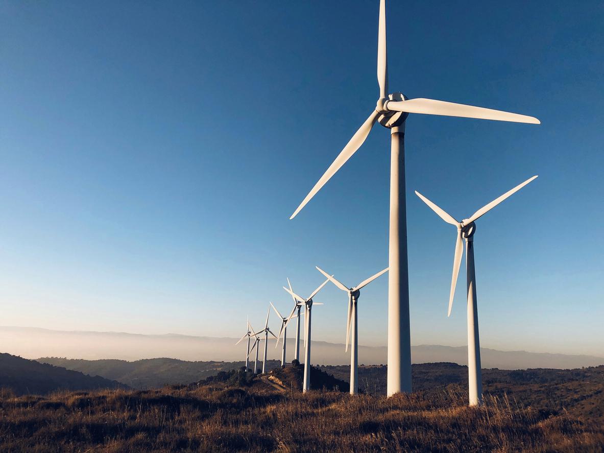 wind turbines against blue sky