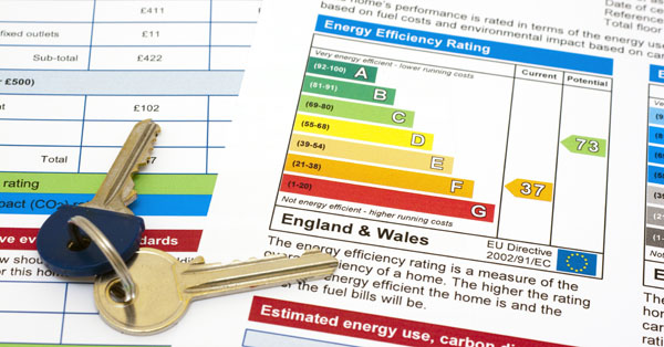energy efficiency performance certificate with keys to flat or house