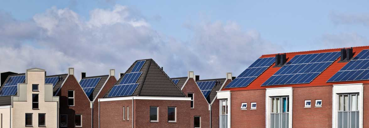 Houses with solar panels in a community generating energy