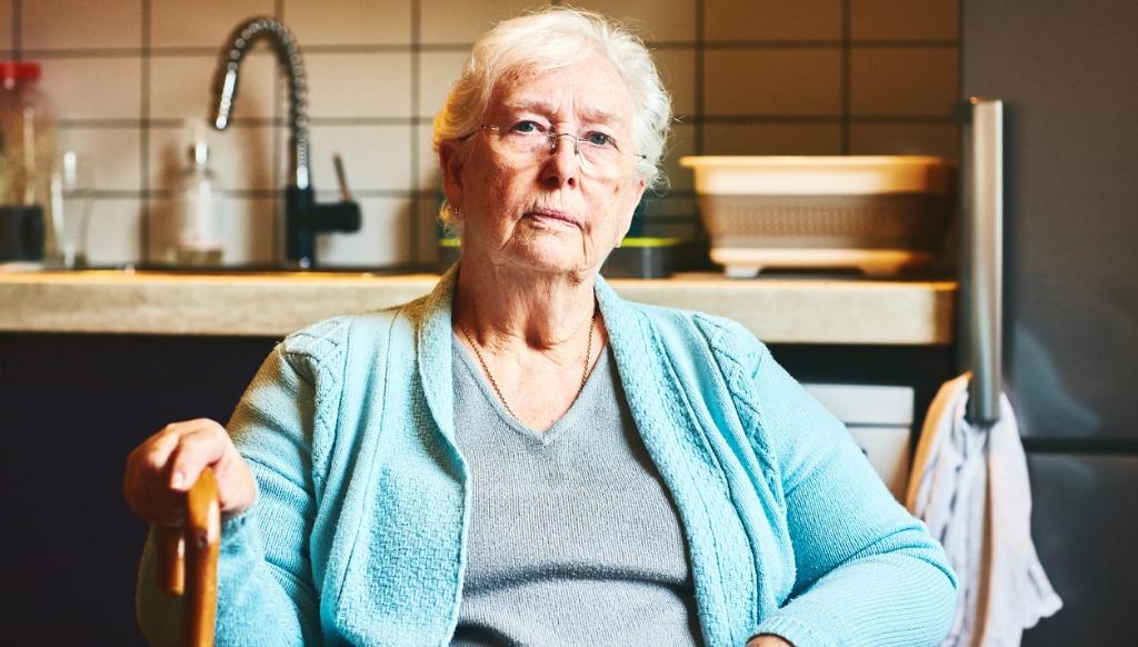 older woman sitting in kitchen