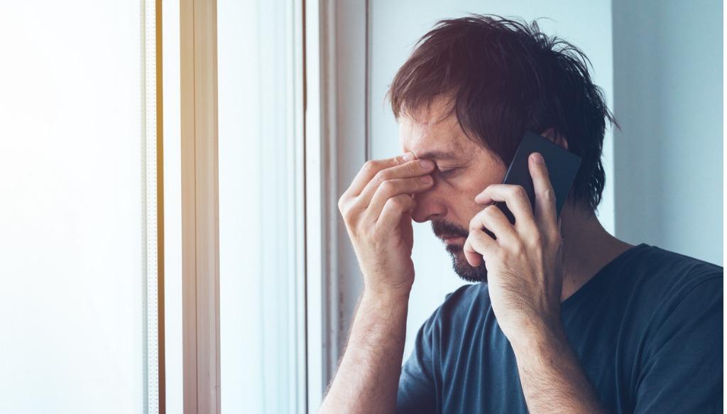 Man making a difficult phone call